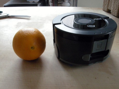 Scooba 230 with an orange for scale